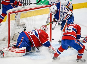 Ryan Nugent-Hopkins scores the first of his two goals on Canadiens goaltender Dustin Tokarsky during the second period Thursday in Montreal. (Martin Chevalier, QMI Agency)