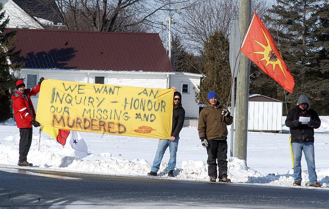 Walpole Island members held a protest at the corner of Highway 40 and Dufferin Avenue in Wallaceburg on Friday, to make people aware of the large number of Canada's murdered and missing indigenous women and call on the federal government to create an independent inquiry to look into the issue. (DAVID GOUGH/ QMI Agency)