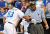 Melky Cabrera (left) argues the strike zone with home plate umpire Dale Scott during MLB action in Kansas City in 2011. The league is considering shrinking the strike zone to help increase more offence, according to a report. (Dave Kaup/Reuters/Files)