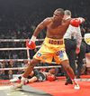 """Adonis Stevenson, celebrating his win over Dmitry Sukhotskiy at the Colisee last December, will have to defend his title on April 4 in Quebec City instead of Toronto because of an Ontario hand-wrap rule that has been called """"silly."""" (QMI Agency photo)"""