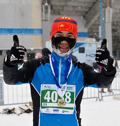 First place medalist Jian He gives the thumbs up after winning the Classic Style 27km race during the Gatineau Loppet in Gatineau, Que., on Saturday, February 14, 2015. Matthew Usherwood/Ottawa Sun