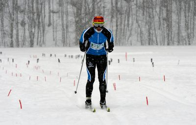First place medalist Jian He crosses the finish line of the Classic Style 27km race during the Gatineau Loppet in Gatineau, Que., on Saturday, February 14, 2015. Matthew Usherwood/Ottawa Sun
