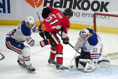 Feb 14, 2015; Ottawa, Ontario, CAN; Ottawa Senators right wing Mark Stone (61) shoots on Edmonton Oilers goalie Richard Bachman (32) in the third period at the Canadian Tire Centre. The Senators defeated the Oilers 7-2. Mandatory Credit: Marc DesRosiers-USA TODAY Sports