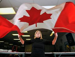 An overwhelming amount of Canadians are proud to fly the Maple Leaf and believe Canada is the best country in the world. (MARK WANZEL/QMI Agency file photo)