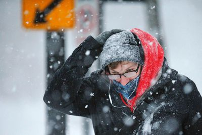 A pedestrian walks through the snow during a blizzard in Cambridge, Mass., Feb. 15, 2015. (BRIAN SNYDER/Reuters)
