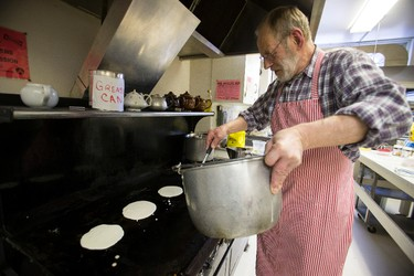 Albert de Vos prepares pancakes during the 37th annual Shrove Tuesday Pancake Supper at Robertson-Wesley United Church in Edmonton, Alta., on Tuesday, Feb. 17, 2015. Proceeds from the supper have gone to mission and service, the RW Music Society and for general church expenses. Shrove Tuesday marks the day before the start of Lent. Ian Kucerak/Edmonton Sun/ QMI Agency