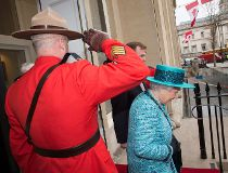 A Mountie salutes as The Queen departs during the re-opening re-juvenated Canada House in London on Thursday February 19, 2015. (SIMON KENT/Special to the Toronto Sun)