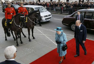 Britain's Queen Elizabeth II (2nd R) and Britain's Prince Philip (R), Duke of Edinburgh arrive for the official reopening of Canada House, the official home to the Canadian High Commission in the United Kingdom, after its restoration and refurbishment on Trafalgar Square in London on February 19, 2015. Canada House was first opened in1925 by King George V.  AFP PHOTO / POOL / KIRSTY WIGGLESWORTH
