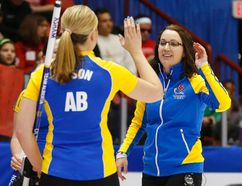 Alberta third Lori Olson-Johns (left) celebrates with skip Val Sweeting after they defeated Team Canada's Rachel Homan during the Scotties Tournament of Hearts in Moose Jaw, Saskatchewan, February 19, 2015. (REUTERS/Todd Korol)