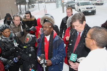 A candlelight vigil was held Saturday at a make-shift memorial in Etobicoke for little Elijah Marsh, 3, who wandered out into the cold and froze to death. Pastor Delroy Williams, from the Open Door Healing Centre, led a crowd of mourners, including Mayor John Tory, in prayer at the Neptune Dr. memorial. CHRIS DOUCETTE/TORONTO SUN
