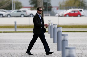 NASCAR driver Kurt Busch leaves the IMC building after a suspension appeal hearing on February 21, 2015 in Daytona Beach, Florida. Busch was suspended indefinitely by NASCAR after a no-contact order was issued against him for alleged abuse against his ex-girlfriend Patricia Driscoll.  Jonathan Ferrey/Getty Images/AFP