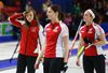 Team Canada skip Rachel Homan, lead Lisa Weagle and second Joanne Courtney react after their loss to Saskatchewan during the Page playoff game in the Scotties Tournament of Hearts in Moose Jaw, Saskatchewan, February 21, 2015. (REUTERS/Todd Korol)
