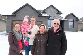 Judy and John Scholz are the grand-prize winners of this year's Dream Home Lottery in Sarnia. They're pictured outside their Kamal Drive prize with daughter Beth Regimbald, her partner Mike, and the Regimbalds' two-year-old daughter Violet. TYLER KULA/ THE OBSERVER/ QMI AGENCY