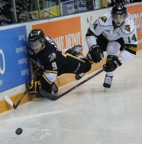Sarnia Sting forward Troy Lajeunesse falls trying to get past London Knights defenceman Brandon Crawley in this filed photo. Lajeunesse is now a members of the Sudbury Wolves. (TERRY BRIDGE/THE OBSERVER)