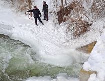 West Grey police officers assist Hanover police near the water's edge by taking a video documenting the spot where Adam Robert Brunt, 30, of Bowmanville, was trapped under ice for approximately 15 minutes during an ice water rescue training exercise in the Saugeen River on Feb. 8.