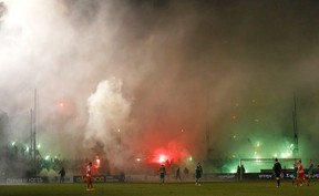Smoke from flares lit by Panathinaikos' fans rises during the Greek Super League soccer match between Panathinaikos and Olympiakos at Leoforos stadium in Athens February 22, 2015. REUTERS/Kostas Tsironis