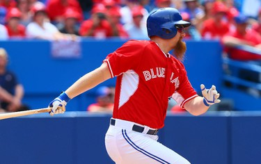 Adam Lind of the Toronto Blue Jays singles in the 8th inning against the Milwaukee Brewers during MLB action at the Rogers Centre in Toronto, Ont. on Tuesday July 1, 2014. Dave Abel/Toronto Sun