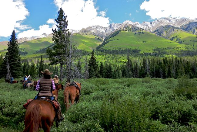 Riders make their way into a meadow in the backcountry of Banff National Park. The Trail Riders of the Canadian Rockies (TRCR) is a non-profit group that�s been operating luxury trail rides for 92 years. PAMELA ROTH/QMI AGENCY