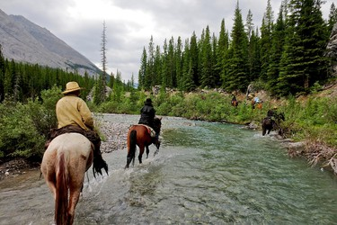 Riders make their way across a stream in the backcountry of Banff National Park. The Trail Riders of the Canadian Rockies (TRCR) is a non-profit group that�s been operating luxury trail rides for 92 years. PAMELA ROTH/QMI AGENCY