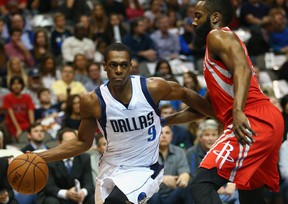 Rajon Rondo #9 of the Dallas Mavericks dribbles the ball against James Harden #13 of the Houston Rockets at American Airlines Center on February 20, 2015 in Dallas, Texas.  Ronald Martinez/Getty Images/AFP