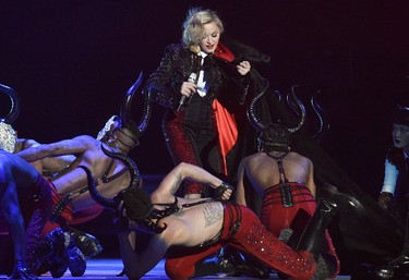 Singer Madonna struggles with her cape after falling during her performance at the BRIT music awards at the O2 Arena in Greenwich, London, February 25, 2015. REUTERS/Toby Melville