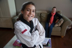 Ainsley Schuck, 10, and her mom, Paula, know first hand the challenges of fetal alcohol spectrum disorder. Schuck, a former Free Press reporter who adopted Ainsley, says schools should invest in aiding sufferers. (DEREK RUTTAN, The London Free Press)