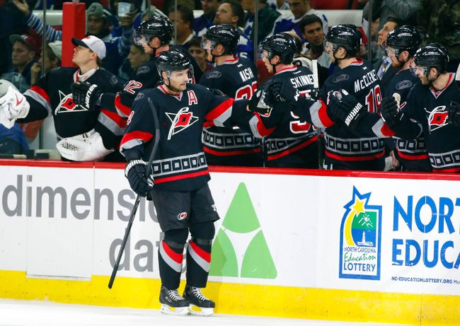 Carolina Hurricanes defencemen Andrej Sekera (4) celebrates his goal with teammates during NHL play against the Toronto Maple Leafs at PNC Arena. (James Guillory/USA TODAY Sports)