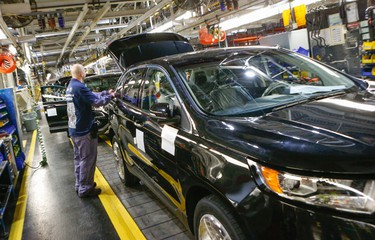 With 400 new jobs on top of the 1,000 new jobs last year. Ford Canada in Oakvillle is proud to announce the all new Ford Edge. Workers on the line on Thursday February 26, 2015. Dave Thomas/Toronto Sun