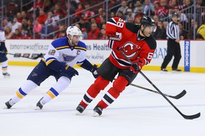 New Jersey Devils winger Jaromir Jagr (68) skates with the puck as St. Louis Blues centre David Backes chases during NHL play at the Prudential Center. (Ed Mulholland/USA TODAY Sports)