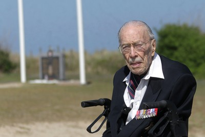 TO GO WITH AFP STORY BY ANNE MEYER 101 years old canadian veteran Ernest Cote poses in Juno Beach on April 17, 2014 in Courseulles-sur-Mer, western France. Ernest Cote landed on June 6, 1944 at 11:00am at Juno Beach. AFP PHOTO / CHARLY TRIBALLEAU