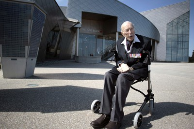TO GO WITH AFP STORY BY ANNE MEYER 101 years old canadian veteran Ernest Cote poses in front of the Juno Beach museum in Juno Beach on April 17, 2014 in Courseulles-sur-Mer, westren France. Ernest Cote landed on June 6, 1944 at 11:00am at Juno Beach. AFP PHOTO / CHARLY TRIBALLEAU