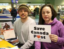 <p>Richard Pepin and Amanda Kingsbury, of the Canadian Union of Postal Workers, Local 612, were in the Rainbow Centre in Sudbury, Ont. holding an information session for the public on the impact of Canada Post's service cuts on Thursday February 26, 2015. John Lappa/Sudbury Star/QMI Agency