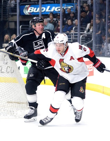 LOS ANGELES, CA - FEBRUARY 26: Matt Greene #2 of the Los Angeles Kings slows Bobby Ryan #6 of the Ottawa Senators to the puck during the first peirod at Staples Center on February 26, 2015 in Los Angeles, California.   Harry How/Getty Images/AFP == FOR NEWSPAPERS, INTERNET, TELCOS & TELEVISION USE ONLY ==