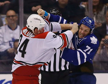 Leafs David Clarkson fights Brad Malone as Maple Leafs host the Carolina Hurricanes at the Air Canada Centre in Toronto on Monday January 19, 2015. Michael Peake/Toronto Sun