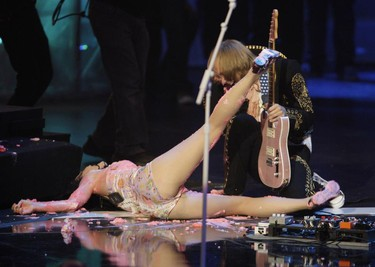 Singer Katy Perry slips on the icing of a giant cake that she had jumped onto as part of her performance at the MTV Latin America Awards in Guadalajara, MexicoOctober 16, 2008.     REUTERS/Daniel Aguilar