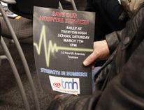 """A supporter of Trenton Memorial Hospital (TMH) holds a flyer advertising a rally in support of TMH organized by the """"Our TMH"""" group slated for Saturday, March 7, while MPP of Northumerland-Quinte West Lou Rinaldi, top, announces $3.5 millions in support to Quinte Health Care (QHC), including"""