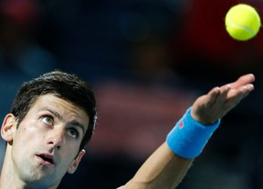 Novak Djokovic of Serbia serves to Tomas Berdych of Czech Republic during their semi-final match at the ATP Championships tennis tournament in Dubai, February 27, 2015. (REUTERS/Ahmed Jadallah)