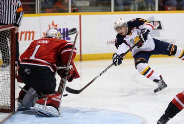 Barrie Colts left wing Kevin Labanc takes a shot on Owen Sound Attack goalie Jack Flinn during Ontario Hockey League action at the Harry Lumley Bayshore Community Centre in Owen Sound, Ont., Wednesday, Feb, 25, 2015. (James Masters/Owen Sound Sun Times/QMI Agency)