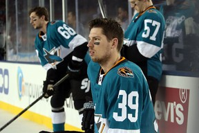 Logan Couture of the San Jose Sharks watches warm ups against the Los Angeles Kings at Levi's Stadium on February 21, 2015. (Bruce Bennett/Getty Images/AFP)