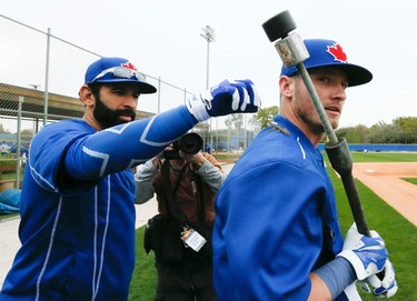 Jose Bautista  discovered a salamander in the grass and placed it on Josh Donaldson's shoulder as Jose joined his team mates at the Toronto Blue Jays Spring Training in Dunedin, Florida on Friday February 27, 2015. Stan Behal/Toronto Sun/QMI Agency