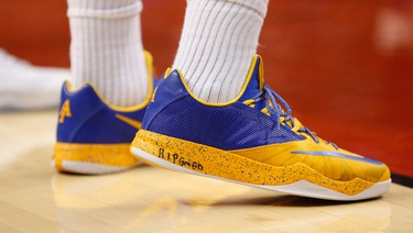 Golden State Warriors' Marreese Speights (5) has a tribute on his shoes during NBA action at the half  in Toronto, Ont. on Friday February 27, 2015. Jack Boland/Toronto Sun/QMI Agency
