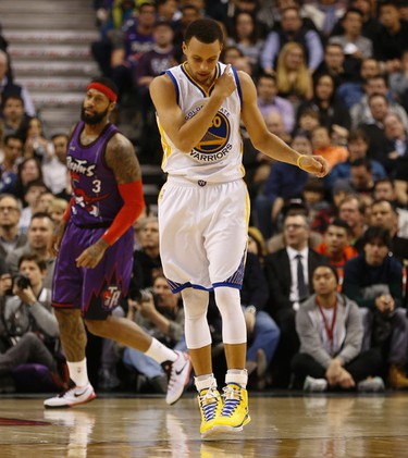 Golden State Warriors' Stephen Curry (30) is pumped after draining points during NBA action at the half  in Toronto, Ont. on Friday February 27, 2015. Jack Boland/Toronto Sun/QMI Agency