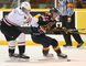 Owen Sound defenceman Thomas Schemitsch (left) tries to tie up the Erie Otters' Connor McDavid in the Attack's 5-4 win on Friday in Ontario Hockey League action.