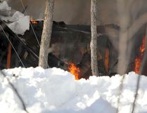 A fire burns a two-storey home at 680 Fifth Line E., on Friday, Feb.27, 2015.