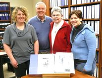 Bluewater Outdoor Education Centre site manager Deborah Diebel (left) presented Bruce County Museum and Cultural Centre archivist Ann-Marie Collins (right) with a binder detailing the history of the site and its 40-year development. Ron Marshall and wife Nancy, a descendant of the first pioneer family- the Masons - to settle on the BOEC property, attended the Feb. 23 donation. Treasured Mason family items, not donated to the archives, include a farm record book, family Bible, and a heart-shaped tortoise shell pin that belonged to Marshall's great-great grandmother.