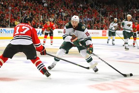 Minnesota Wild left winger Dany Heatley skates against Chicago Blackhawks defenseman Sheldon Brookbank during Game 5 of the second round of the 2014 NHLPlayoffs at the United Center on May 11, 2014. (Dennis Wierzbicki/USA TODAY Sports)