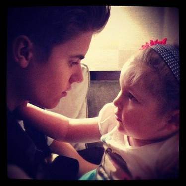 """He flew out to meet one of his biggest fans, a cancer patient nicknamed """"Mrs. Bieber""""On Valentine's Day 2012, Bieber visited 6-year-old Avalanna Routh, who was suffering from a rare form of cancer called atypical teratoid rhabdoid tumor. The two formed a strong friendship, and he took her on a tour of New York City in June. Avalanna died that year. (Justin Bieber/Instagram)"""