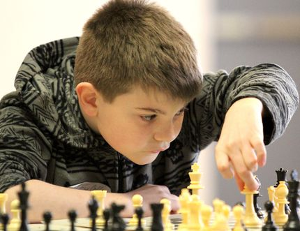 Riley Collins, a student at Echo Bay Central, considers his next move during 2014 tournament action.