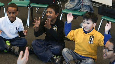 Children of all ages learn music at the Regent Park School of Music on Wednesday, Feb. 25, 2015. Veronica Henri/Toronto Sun/QMI Agency