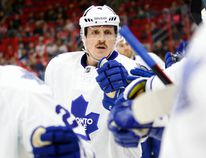 Toronto Maple Leafs defencemen Dion Phaneuf (3) celebrates his second period goal with teammates against the Carolina Hurricanes at PNC Arena. (James Guillory-USA TODAY Sports)